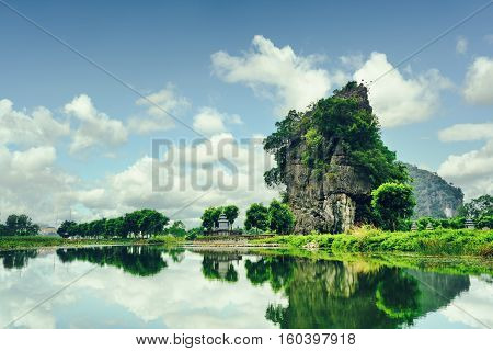 Beautiful Natural Karst Tower Reflected In Water. Toned Image