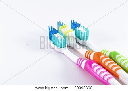 Dental Care - Multicolored toothbrushes on white background
