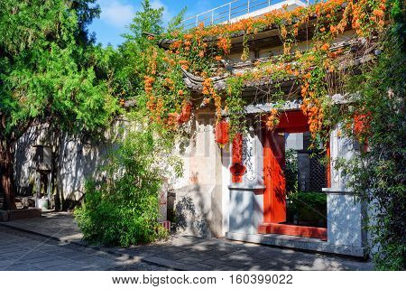 Gate Of Traditional Chinese House Decorated With Flowers, Dali