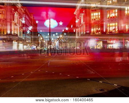 LONDON ENGLAND - DECEMBER 3: Motion blur of a London red bus on Oxford Circus at night at Christmas. In London England. On 3rd December 2016.