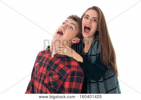 portrait of happy stylish couple in love having fun in studio isolated on white background