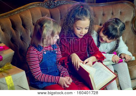 Santa Claus And Group Of Girls Reading A Book