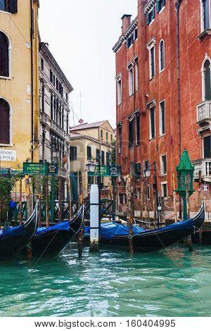 Gondolas Service In Venice In Rain
