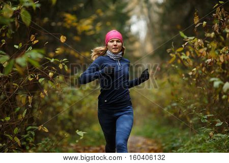 Blonde woman running in morning
