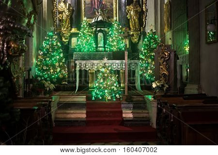 POLAND KRAKOW - JANUARY 01 2015: Main altar of The Church of St. Andrew in Christmas decoration. Romanesque church built between 1079 and 1098. Interiors in baroque-rococo architecture style.