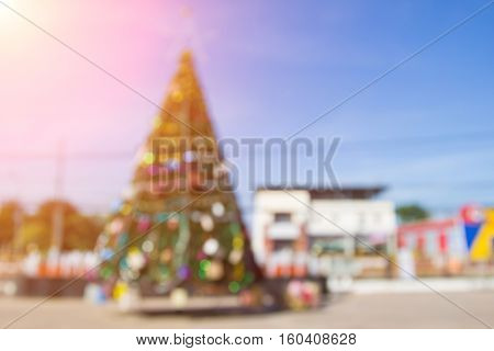 Blurred christmas tree lights on background.design effect focus happy holiday party colorful ball glow texture white wall paper red green yellow gift shining celebrate xmas winter offer bestow furnish