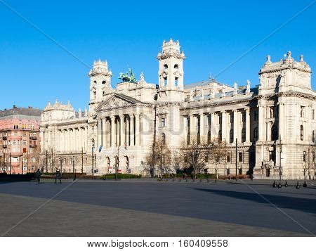 Hungarian National Museum of Ethnography, aka Neprajzi Muzeum, at Kossuth Lajos Square in Budapest, Hungary, Europe. View of entrance portal with two towers and architectural columns on sunny day with clear blue sky. UNESCO World Heritage Site.