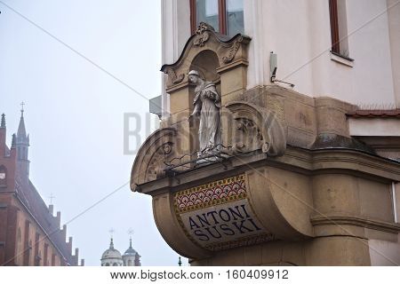 POLAND KRAKOW - JANUARY 01 2015: Details of historic House of Suski in Krakow. The house was built in the style of modernism with the statue of Saint Mary in the corner portal. Designed by Wladyslaw Ekielski in the years 1906-1909.