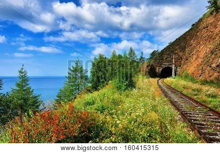 Baikal landscape. Short browsing railway tunnel on lake. Irkutsk region. Russia