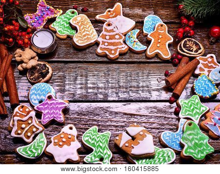 Colorful cookies are in the form of a circle on a wooden table. Merry Christmas.