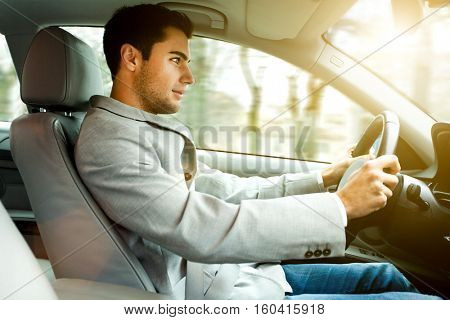 Portrait of a man driving his car