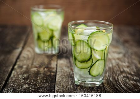 Detox water with cucumber and lemon . Selective focus.