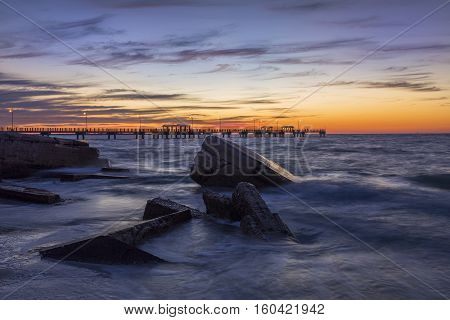 Rocks And Fishing Pier At Sunset - St. Petersburg, Florida