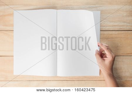 hand open blank book or magazines book mock up on wood background