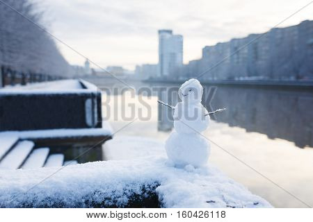 The snowman on a riverbank in Kaliningrad Russia
