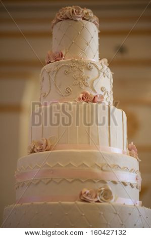 A four tiered Wedding cake at the bakery