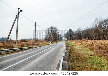 road in the country on gloomy cold autumn day