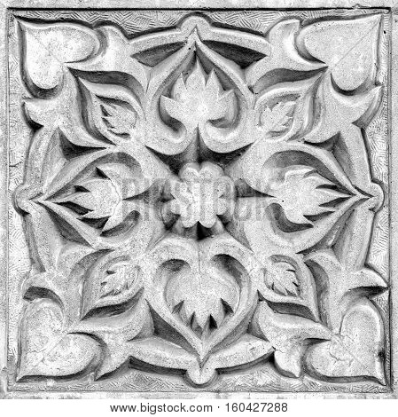abstract floral ornament a stone bas-relief on the wall