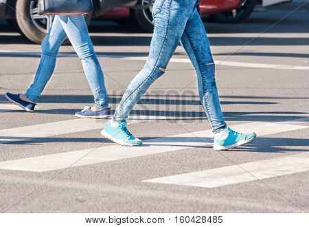 pedestrians women walking on a pedestrian crossing on sunny day