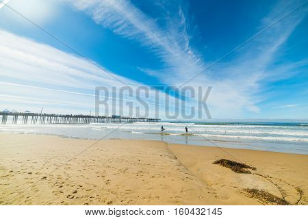 Surfers in Pismo Beach in Southern California