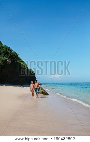 Young Couple Strolling On The Beach
