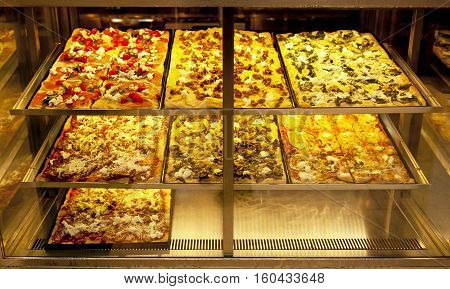 Close up of the various kinds of pizza
