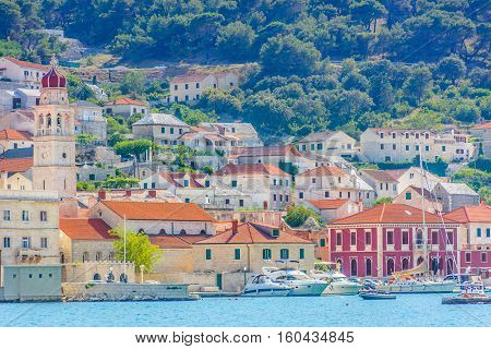 Waterfront view at small picturesque mediterranean town Pucisca, Island, Brac, Croatia Europe.
