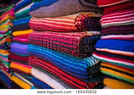 Assortment of Mexican serape blankets or rugs