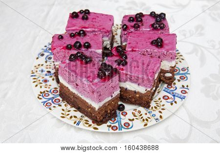Cake with black currant on the decorative plate