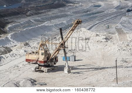 Excavator is working in chalk quarry mining, Belgorod, Russia