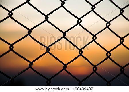 Sunset through a steel mesh Photos backlight