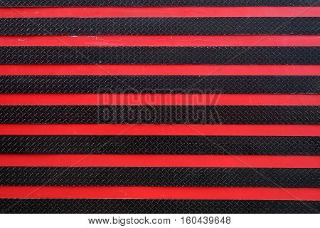 Road background with crossing of red and black road marking and tire