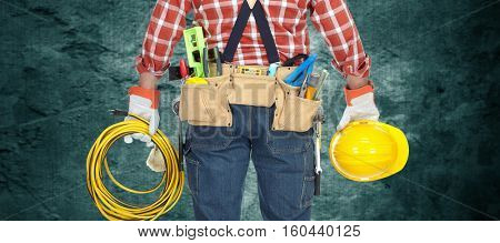 Electrician with helmet and cable.