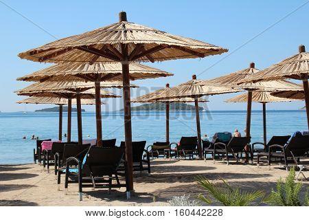 Deckchairs and beach umbrellas on a croatian beach.
