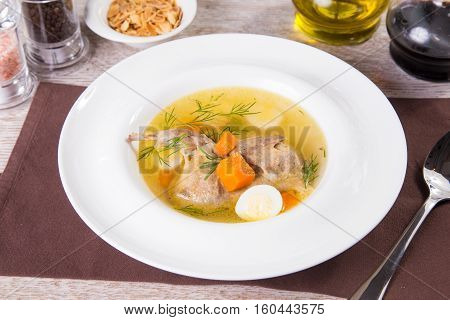 hot fresh soup with duck meat,carrot and egg in white plate