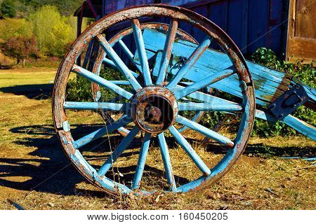 Rustic wooden wagon which is a vintage antique outdoor decoration taken at a ranch in the rural countryside
