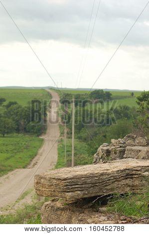Flint rock overlook on dirt road Kansas