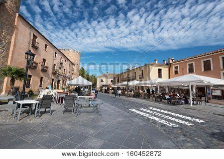 Avila Spain - October 27: Tourist sitting in a terrace enjoying a sunny day on October 272016 in Avila Spain.