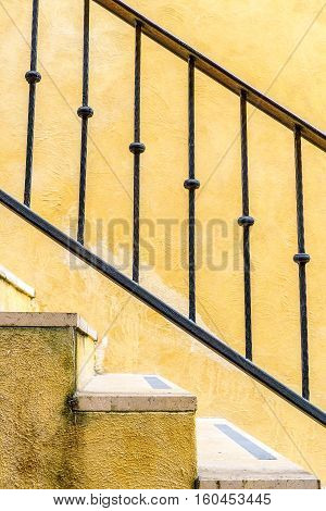 The Staircase with iron railings. Staircase texture.
