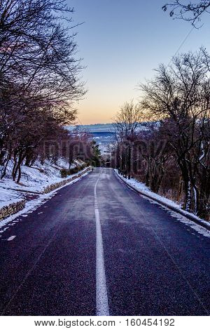the mountain road in the wood, an evening decline, winter