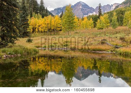 a reflection of the maroon bells Aspen Colorado in fall