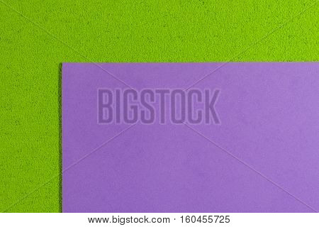 Eva foam ethylene vinyl acetate smooth violet surface on apple green sponge plush background