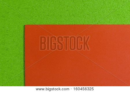 Eva foam ethylene vinyl acetate smooth orange surface on apple green sponge plush background