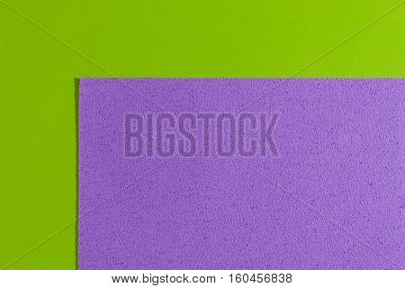 Eva foam ethylene vinyl acetate sponge plush violet surface on apple green smooth background