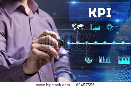 Technology, Internet, Business And Marketing. Young Business Man Writing Word: Kpi