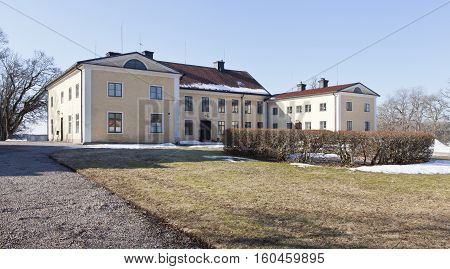 UPLAND, SWEDEN ON APRIL 11. View of a garden, park and a main building on April 11, 2013 in Upland, Sweden. Sunny and chilly morning. Editorial use.