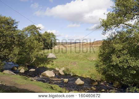 Burbage Brook flows across moorland on the Longshaw Estate Peak District Derbyshire UK