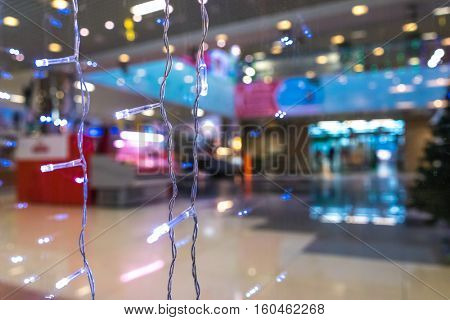 Shopping Mall Interior, Christmas Shopping Mall Defocused Background, Shopping Center, Abstract Blur Image of Shopping Mall and People on Christmas Time for Background