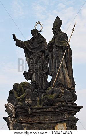 Statue of Saints Vincent of Ferrara and Procopius on the Charles Bridge in Prague Czech Republic