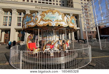 Moscow, Russia - November 21, 2016: Carousel With Horses On The Famous  Manezhnaya  Square Near The